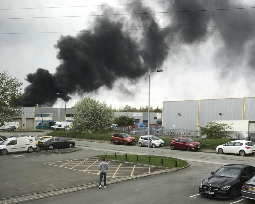 Firefighters urge people to keep away from Flintshire blaze